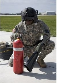 Member of USA military with Class A fire extinguisher